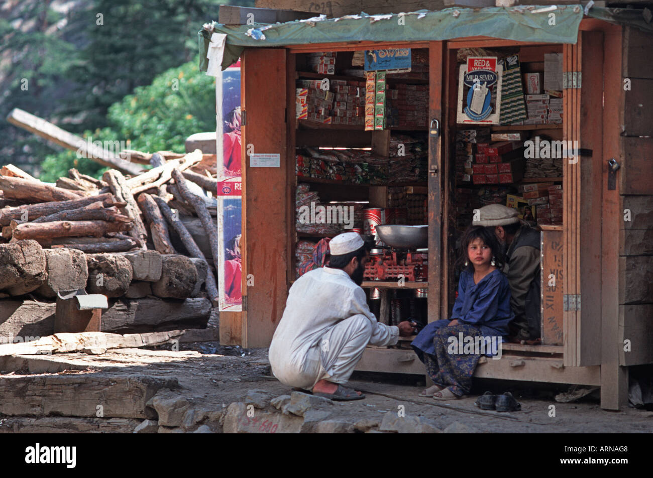 Villagers at at a small local village shop en route from Peshawar to Chittral NW Frontier Province Pakistan - Stock Image