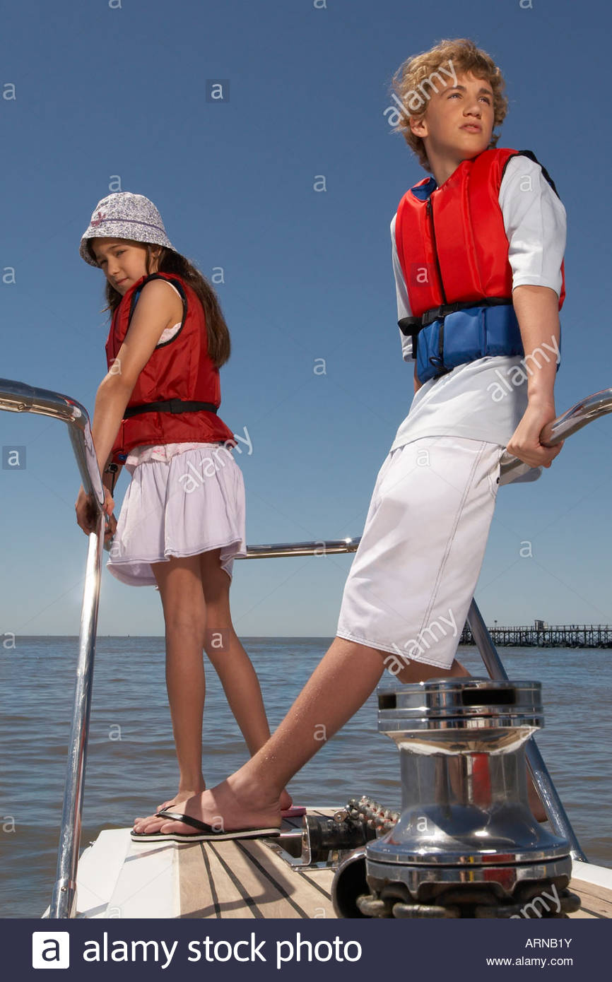 Children standing on boat - Stock Image
