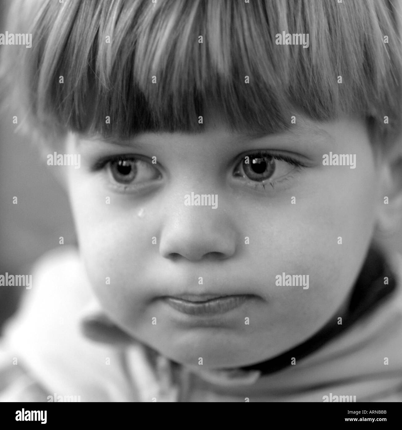 Child s face troubled boy - Stock Image