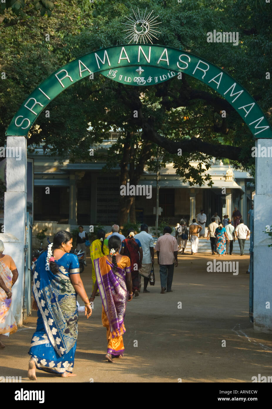 People enter Sri Ramanasramam in Tiruvannamalai in Tamil Nadu India - Stock Image