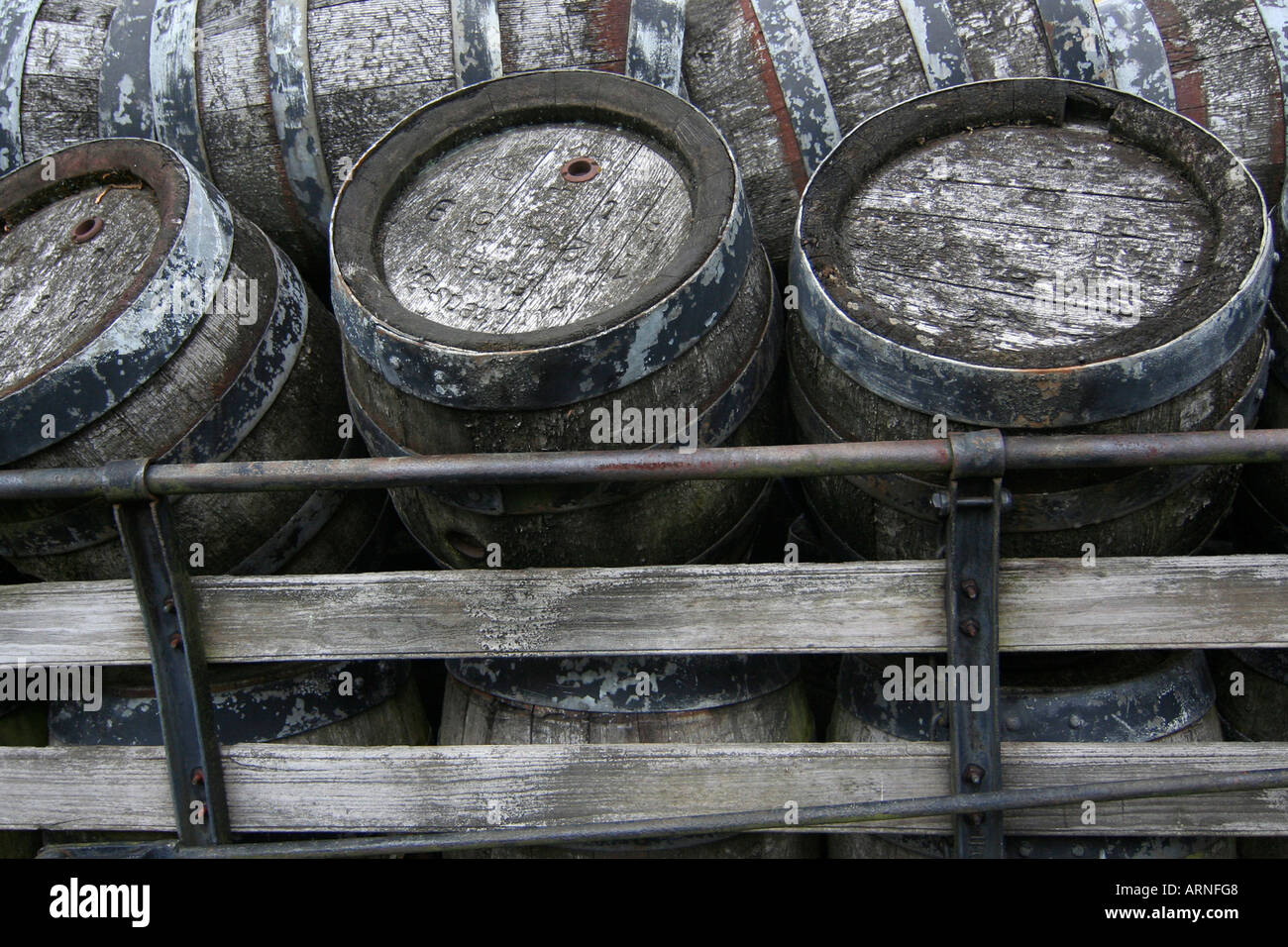 Old wooden beer kegs on a cart - Stock Image