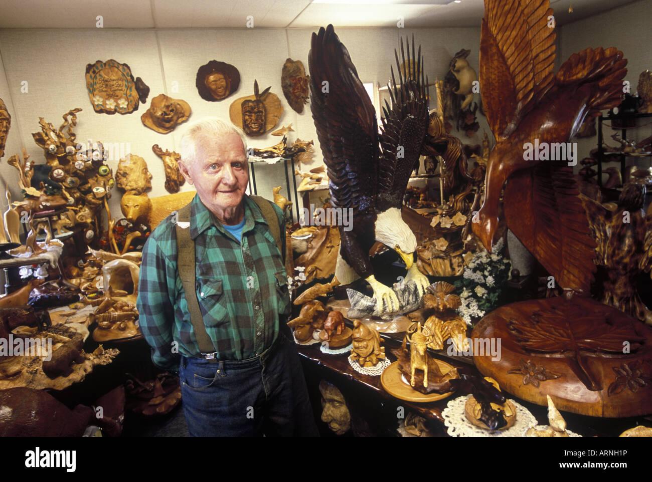 Qualicum Beach Local artisan, woodcarver Paul Bourbeau in his studio, Vancouver Island, British Columbia, Canada. Stock Photo