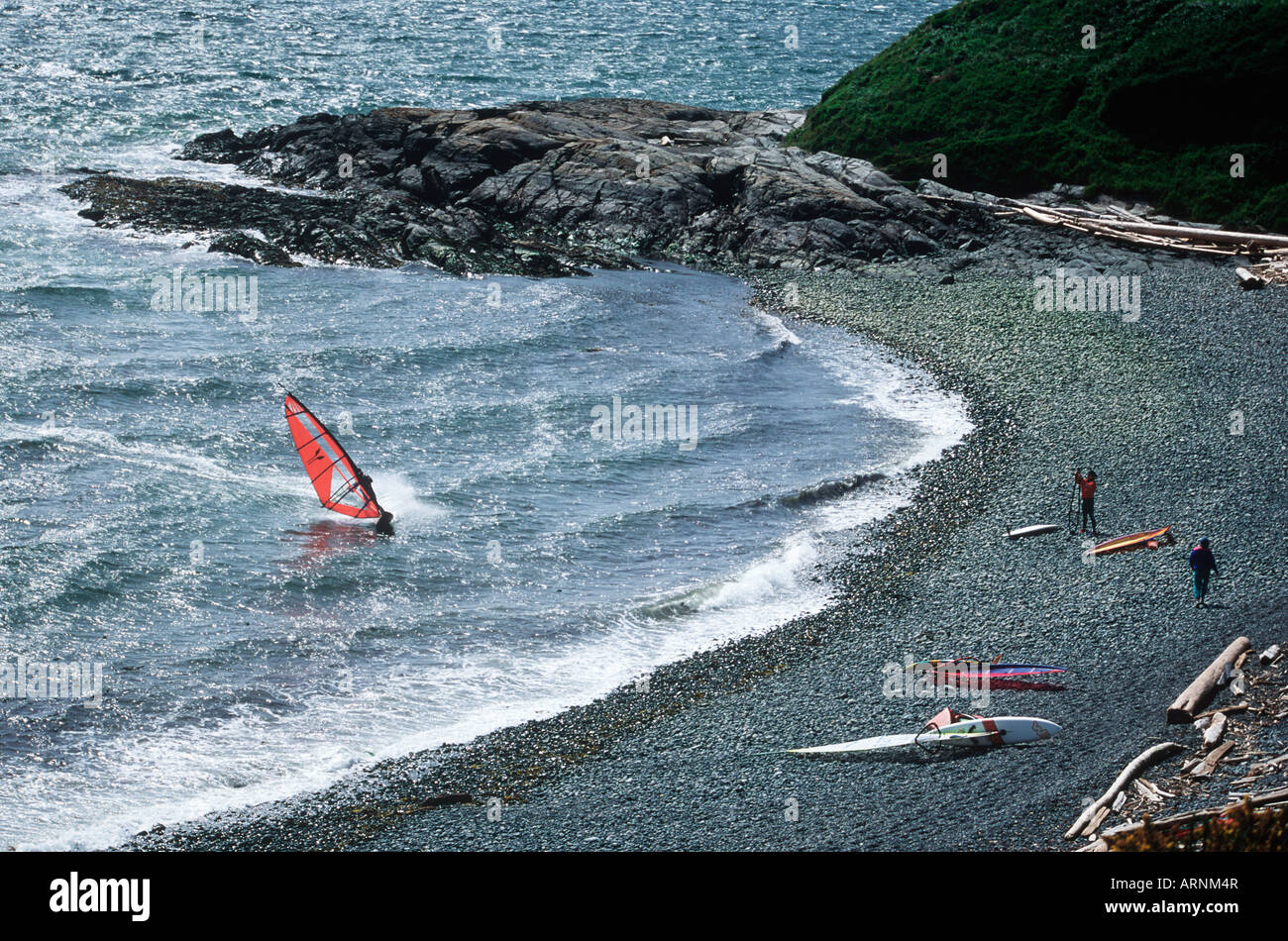 Windsurfer heading towards beach on Dallas Rd, Victoria, Vancouver Island, British Columbia, Canada. - Stock Image