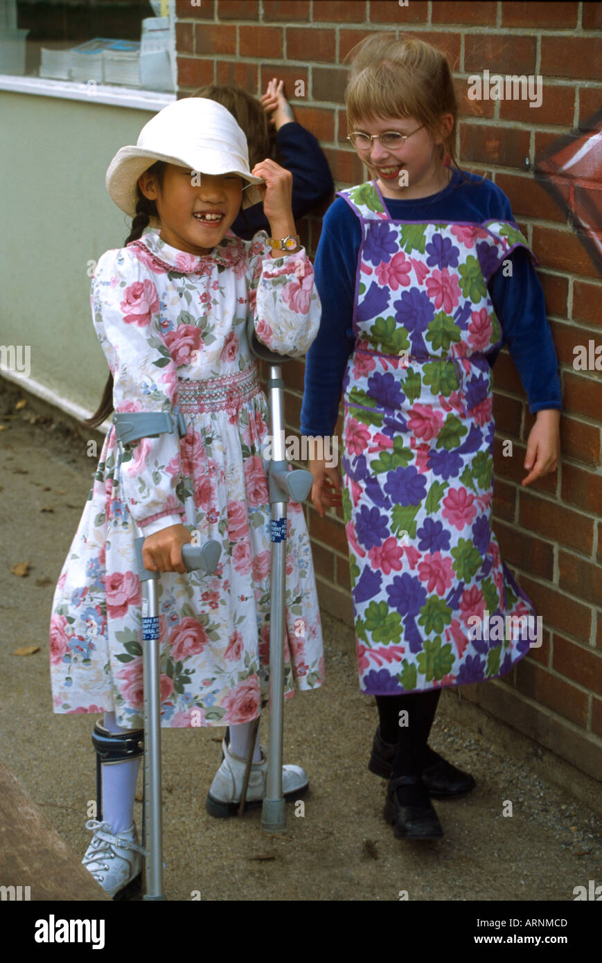 Children Dressed Up As Characters On Book Day Disabled Child Playing - Stock Image