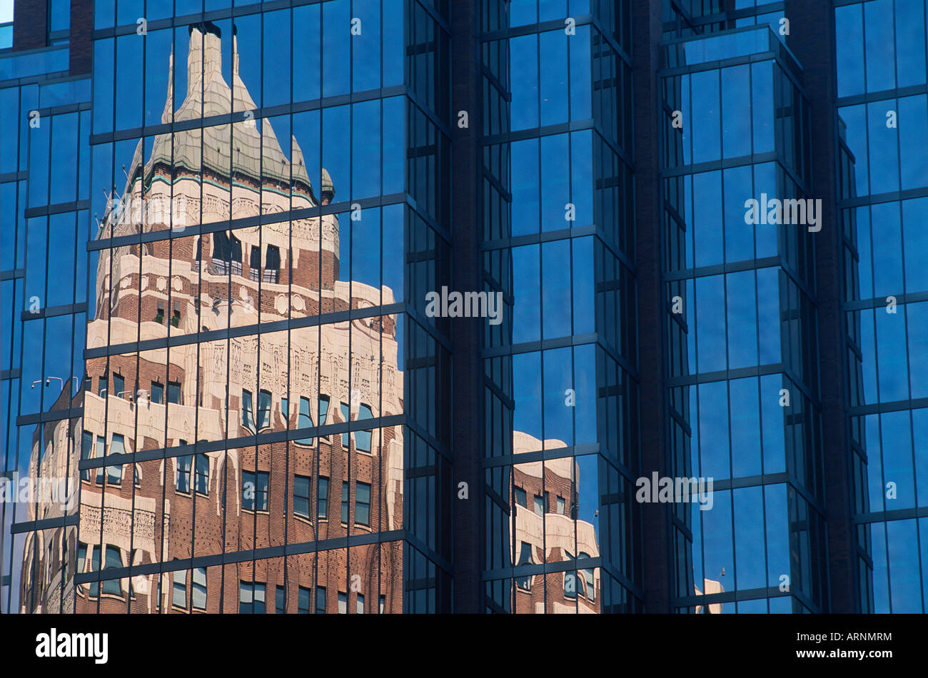 Marine Building reflection in glass office tower ...