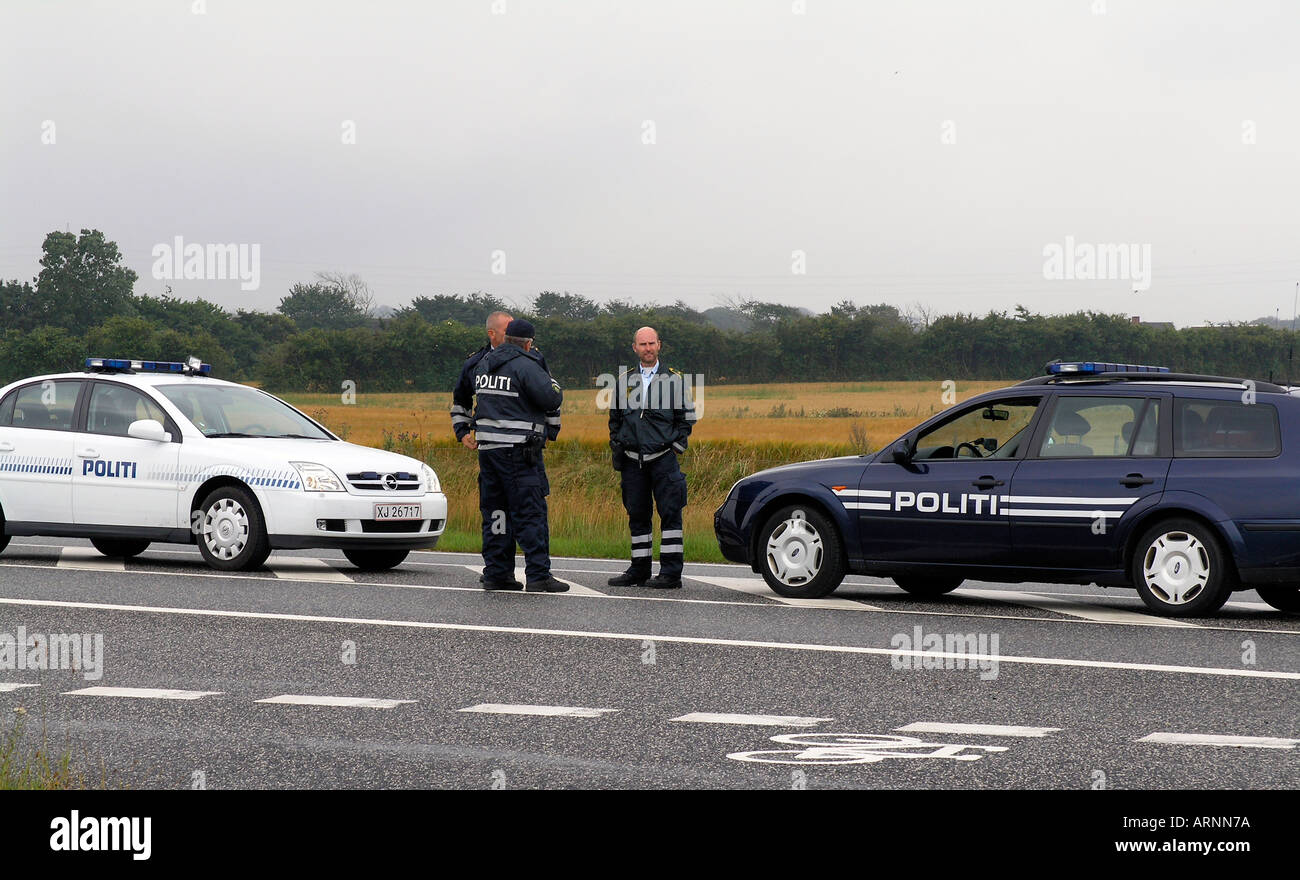 Danish police at work at a roadblock during cycling race in Jutland - Stock Image