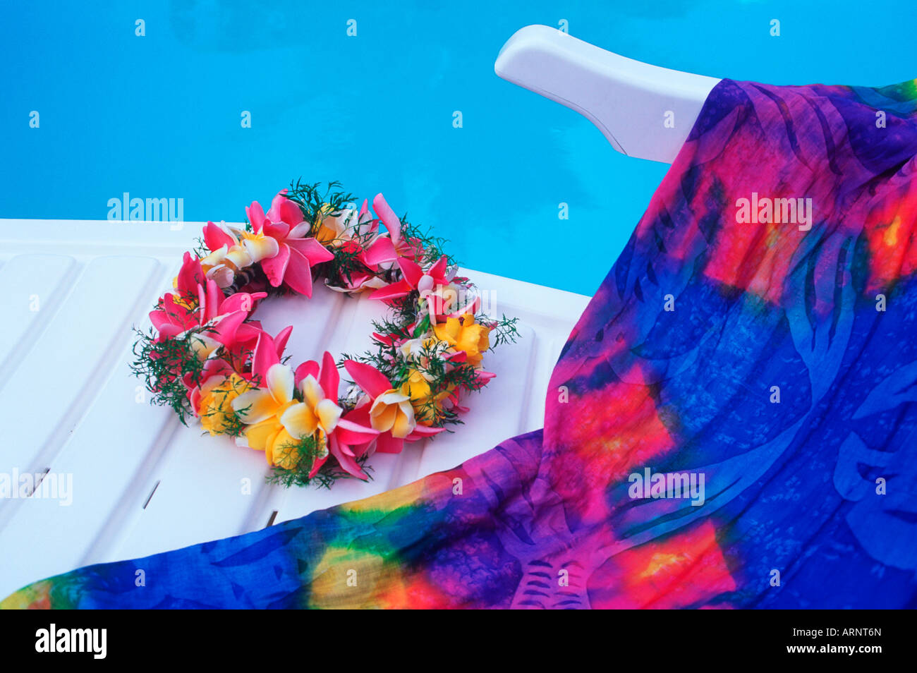 Cook Islands, South Pacific, Raratonga, floral lei on deck chair at poolside - Stock Image