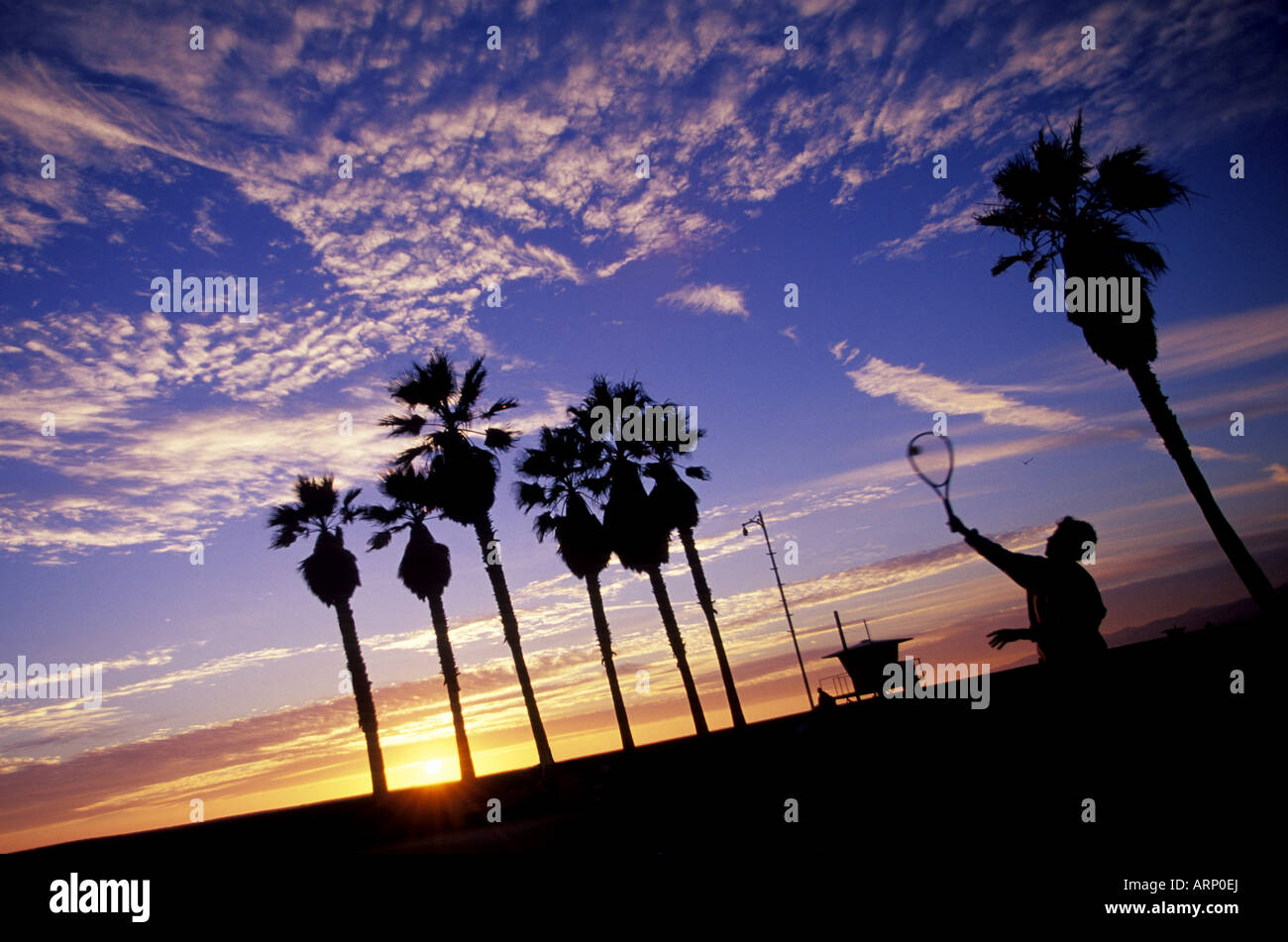 Is Sun Setting On Tennis In America >> Tennis Player Serves Ball Against Sunset Sky Los Angeles Stock