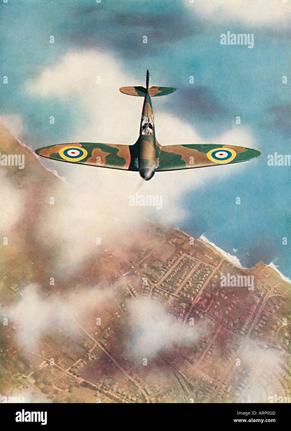 Spitfire 1939 photo of the iconic English fighter plane designed by Reginald Mitchell flying over the English coast - Stock Image