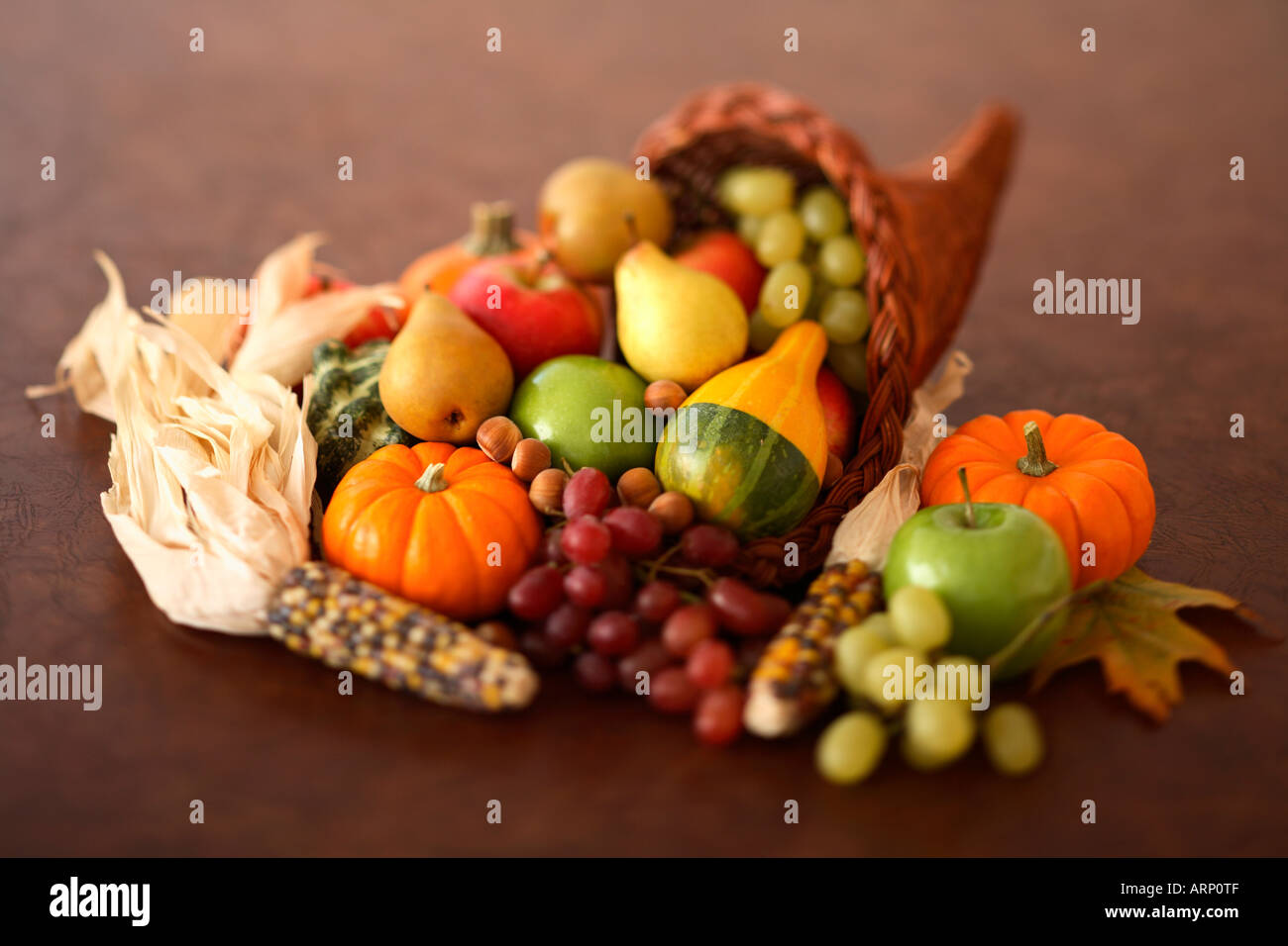Cornucopia with Fall Gourds, Indian Corn, and Fresh Fruits - Stock Image