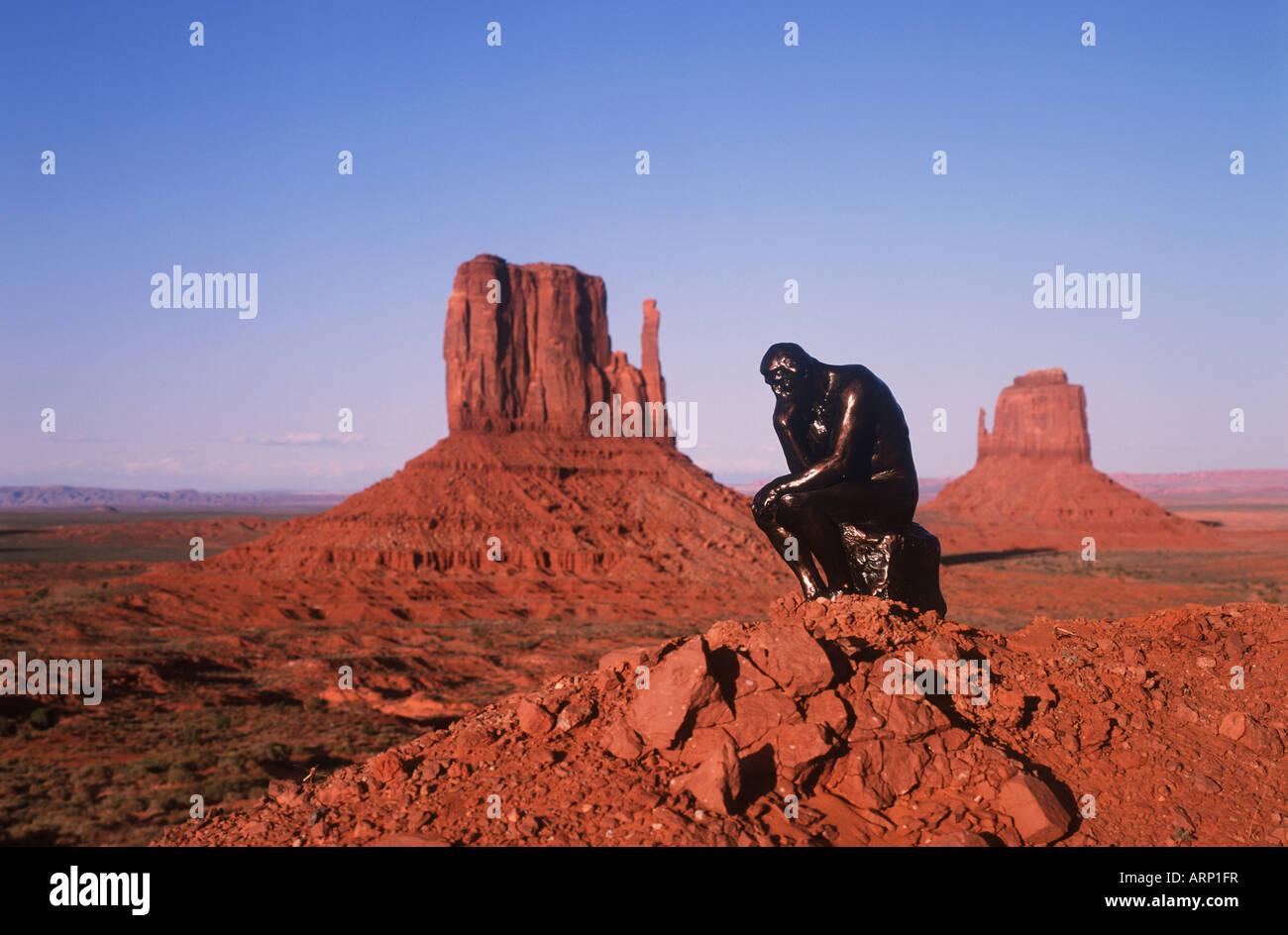 USA, Utah, Monument Valley with 'thinker' statue - Stock Image