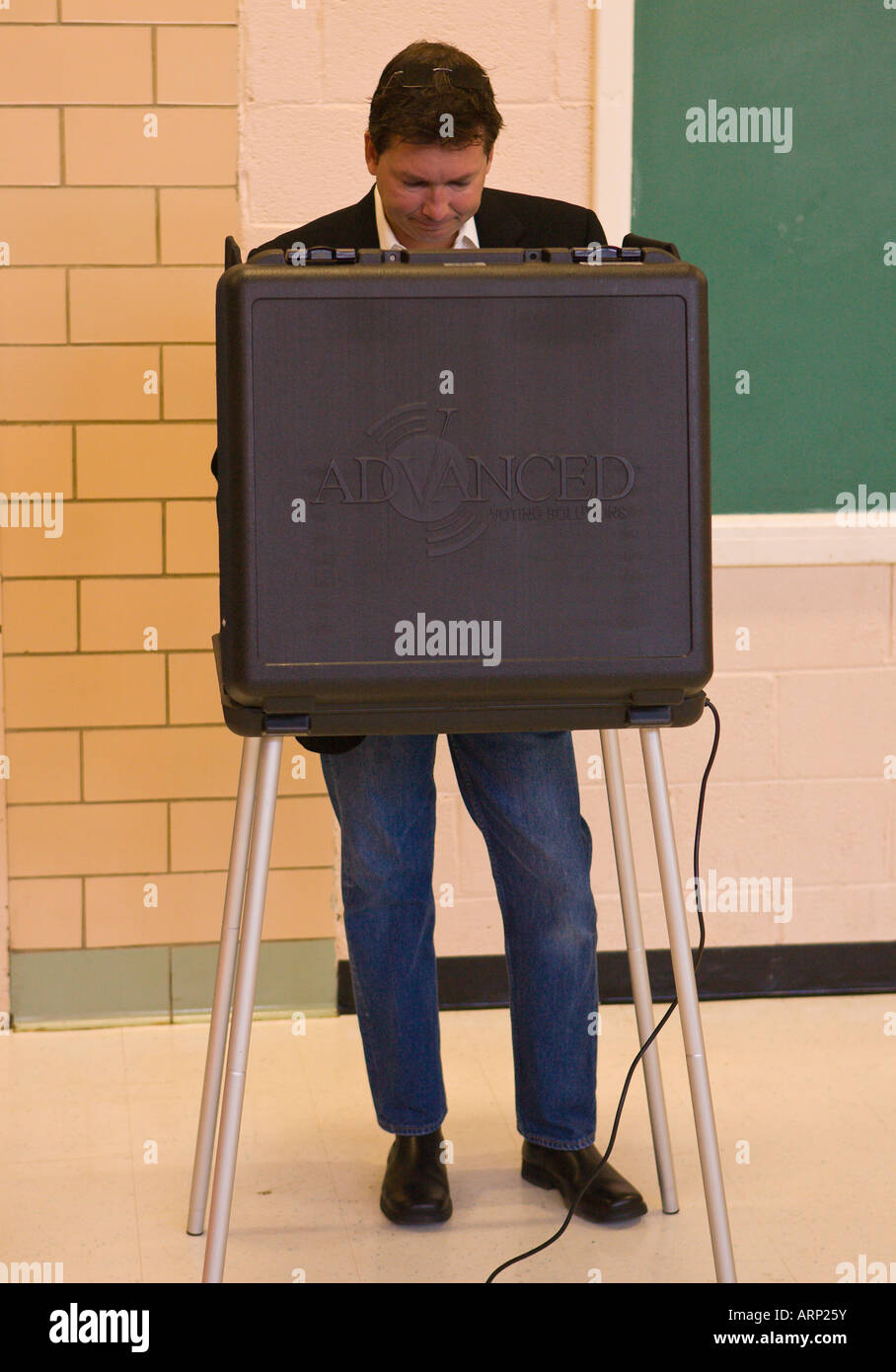 ARLINGTON, VIRGINIA USA Male voter casts ballot in presidential election using touch screen machines - Stock Image