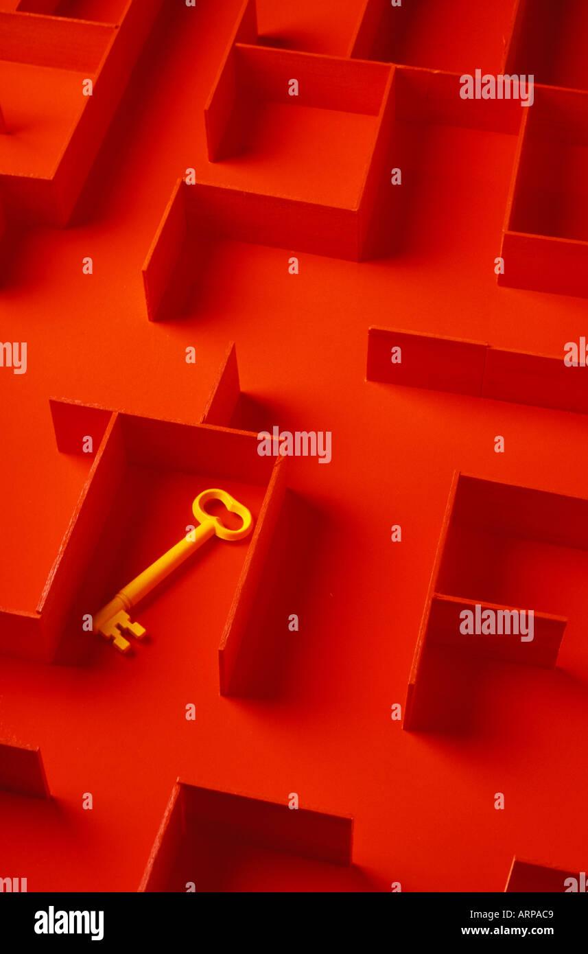 Yellow key in orange maze - Stock Image