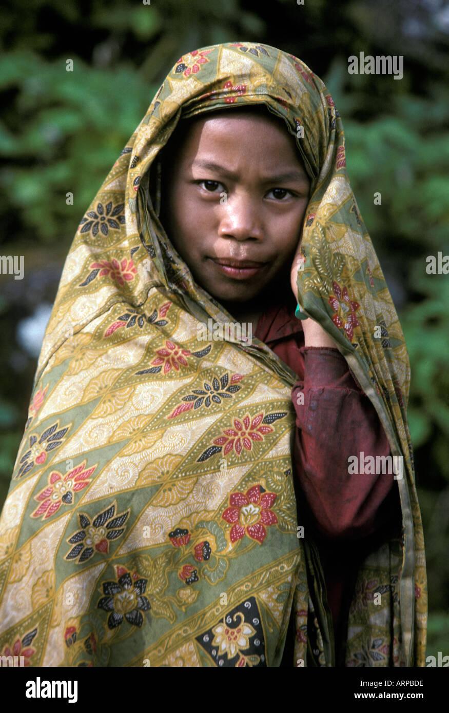 Indonesian boy wrapped in his mothers batik sarong Toraja village near Rantepao Tanatoraja Sulawesi Indonesia - Stock Image