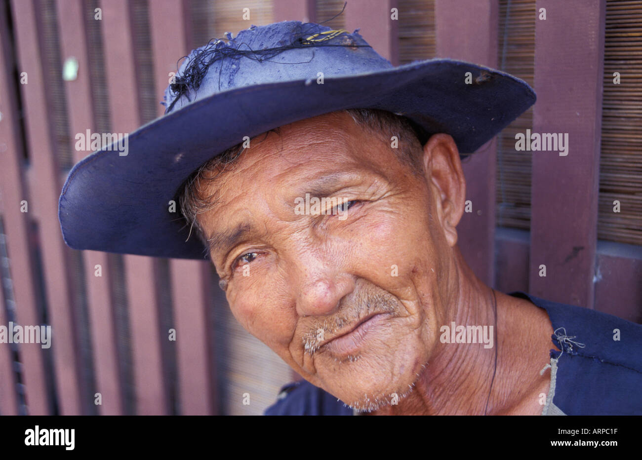 Thai fisherman posing for a portrait Hua Hin Southern Thailand - Stock Image