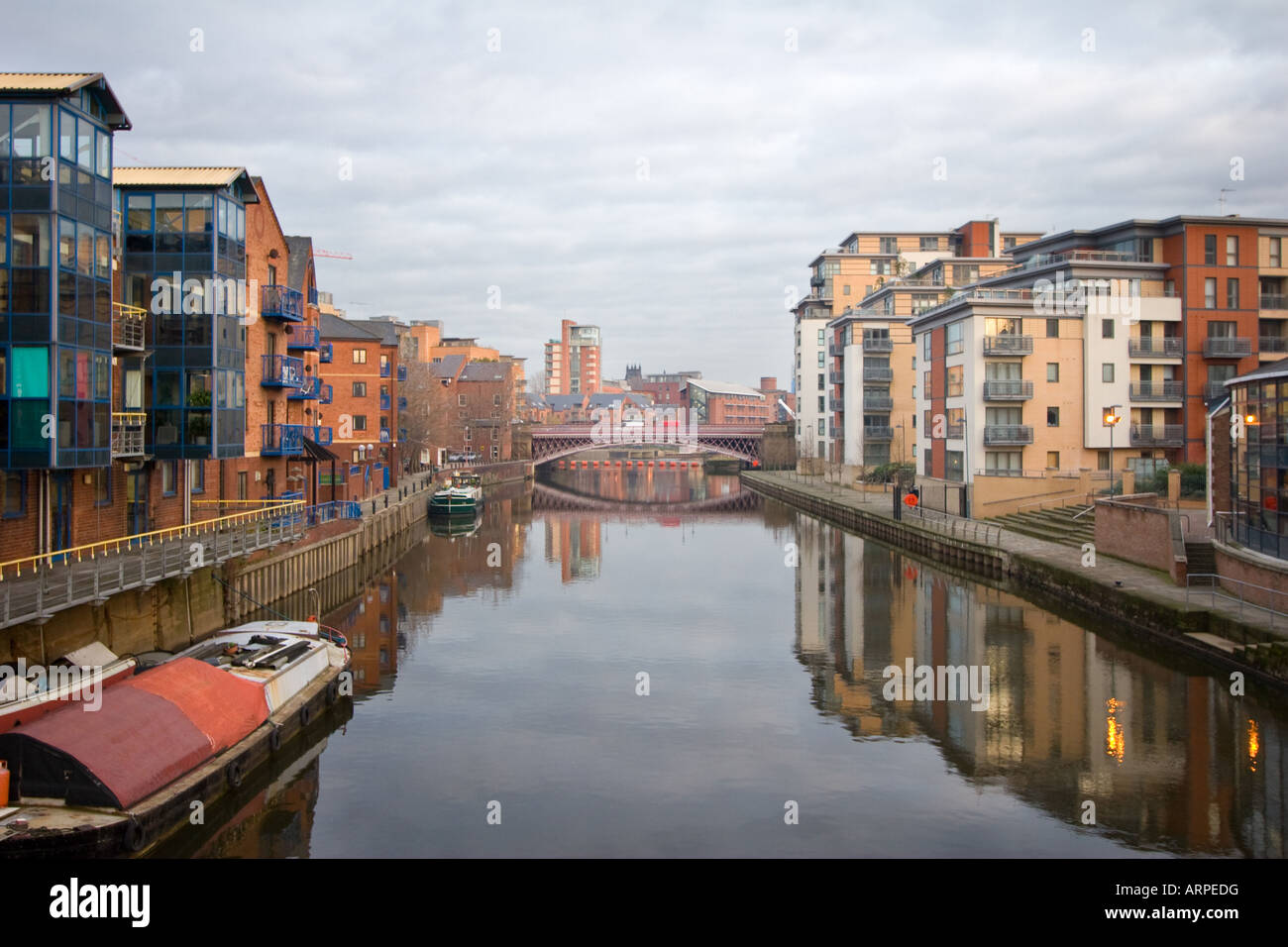 The river Aire runs beneath a bridge near the Royal Armouries in Leeds West Yorkshire England December 12 2007 - Stock Image