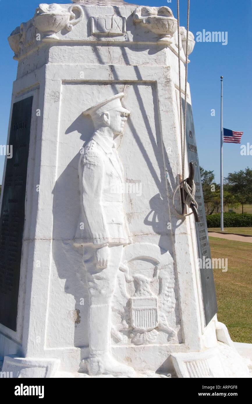 White Marble Flagpole Base, American Flag flying at Half- Mast, Texas A&M University, Collage Station, Texas - Stock Image