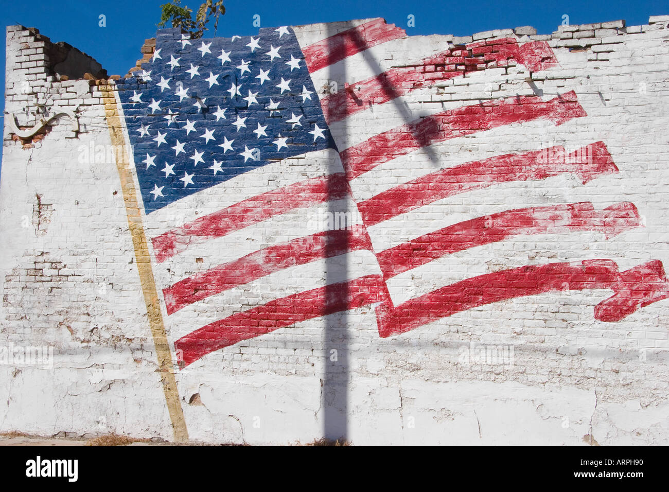 Faded Painted American Flag on a Crumbling Building, Calvert, Texas Stock Photo