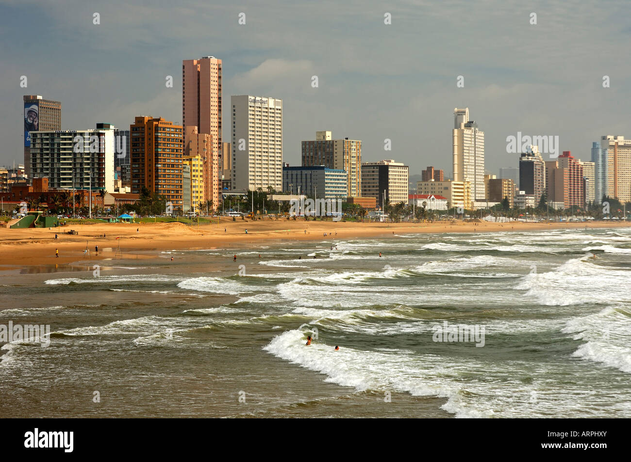 Sandy Golden Mile beaches along the Indian Ocean and skyline of Durban South Africa - Stock Image