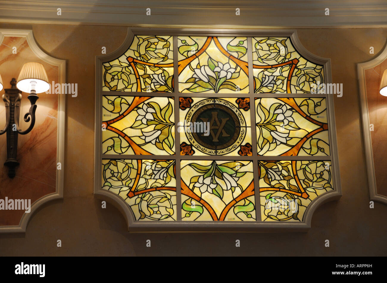 The Queens Room on Cunard's cruise ship, Queen Victoria, is decorated with stained glass panels. - Stock Image