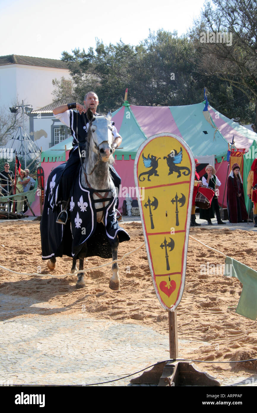 Lusitanian Horse Show knight charging in Medieval costume at Historic Parade Festival dos Descobrimentos Lagos Algarve Portugal - Stock Image