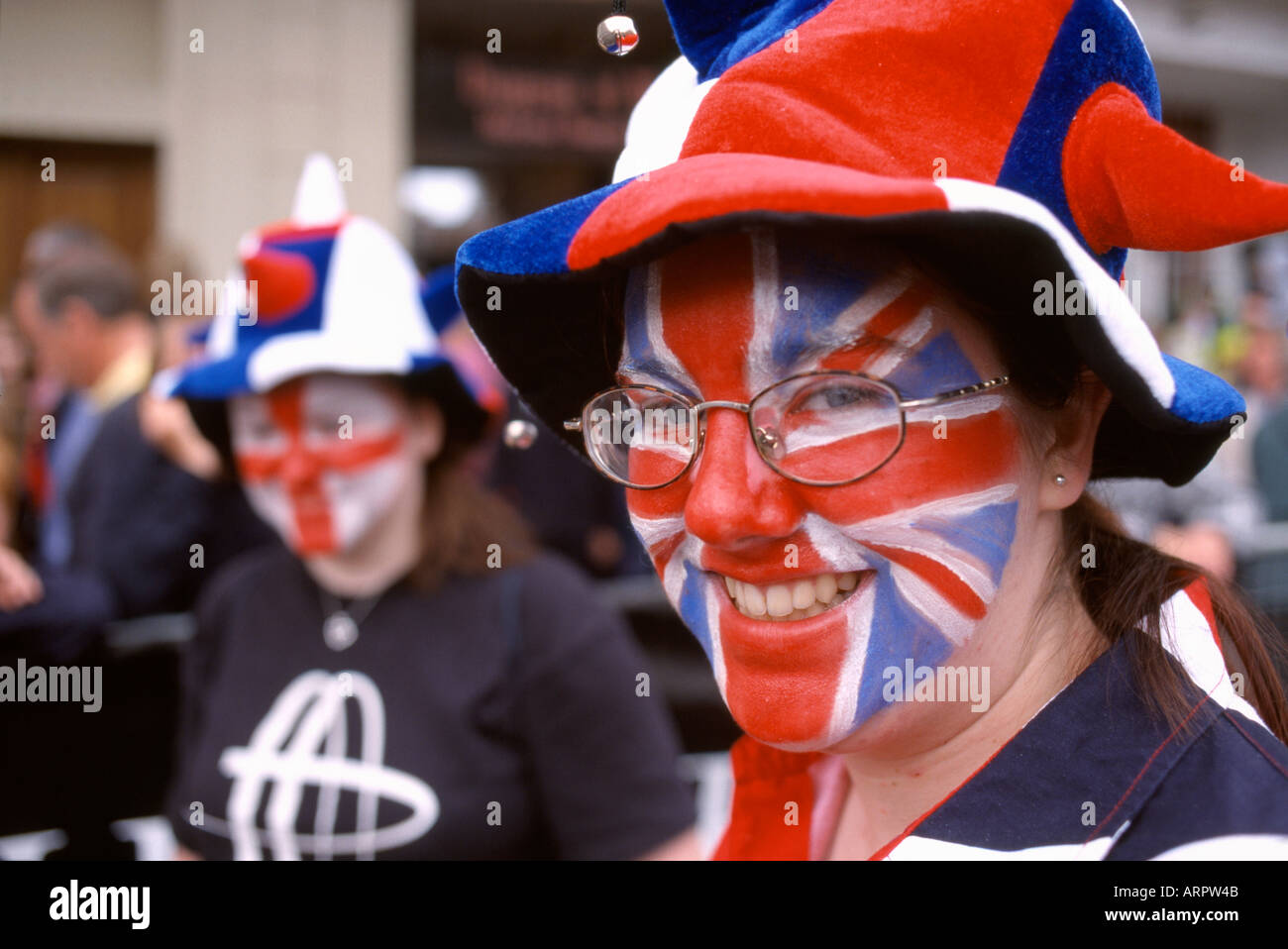 women girls with union jack flag painted faces - Stock Image