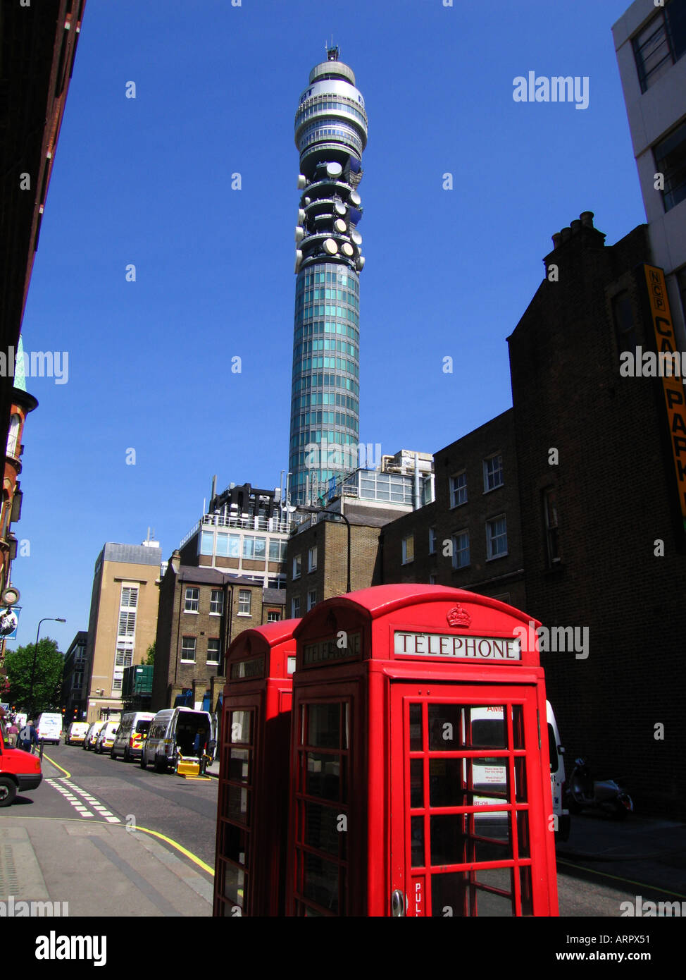 Telephone kiosk with BT Tower in the distance City of Westminster Central London London England Great Britain United Kingdom Eur - Stock Image