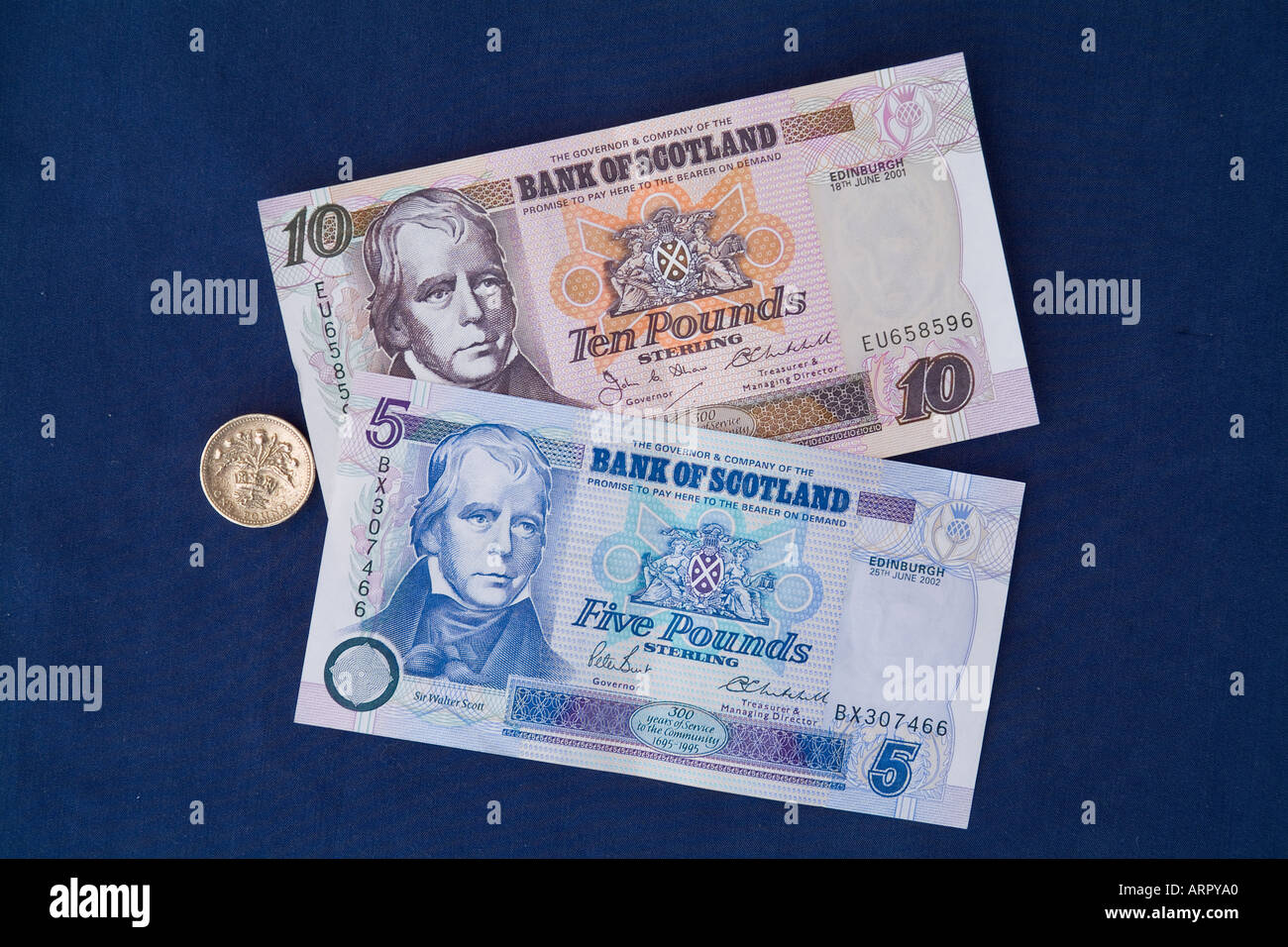 dh Bank of Scotland cash MONEY SCOTLAND UK Scottish five ten pound notes one pound sterling thistle coin paper currency Stock Photo