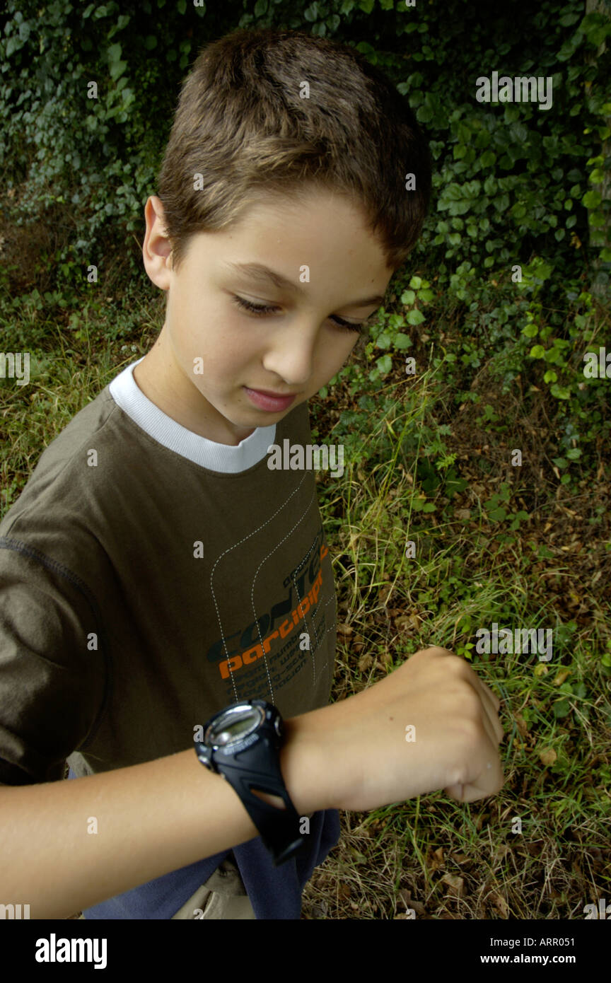 Ten Years Old Boy Proud Of His First Watch - Stock Image