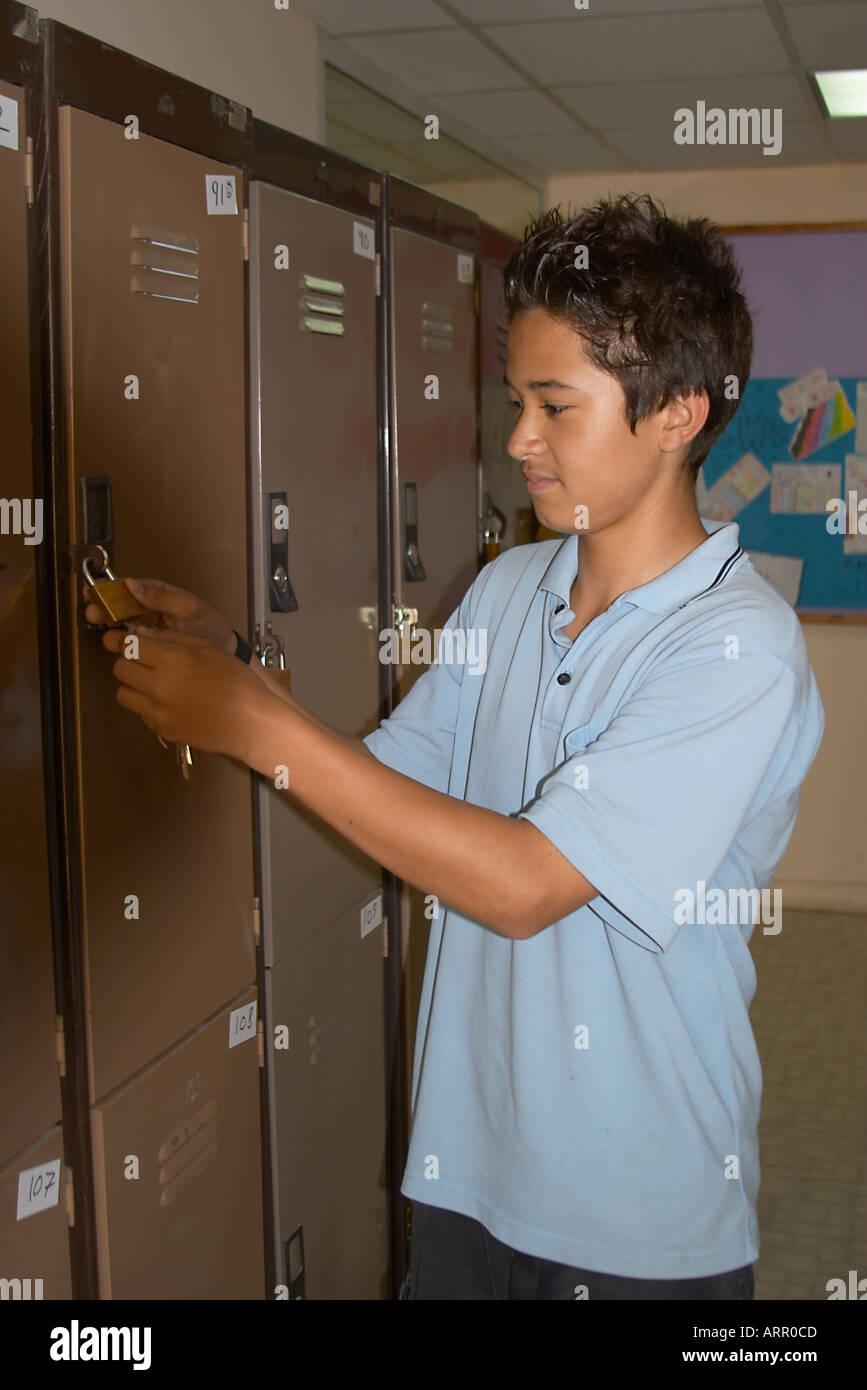 teenage school boy in locker room at school Stock Photo