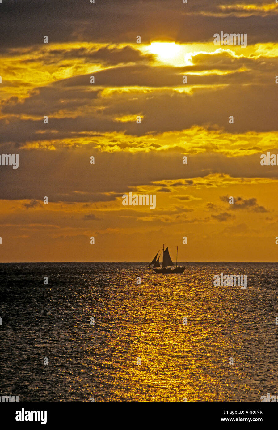 0438 Sailing boat at sunset Negril Jamaica West Indies - Stock Image