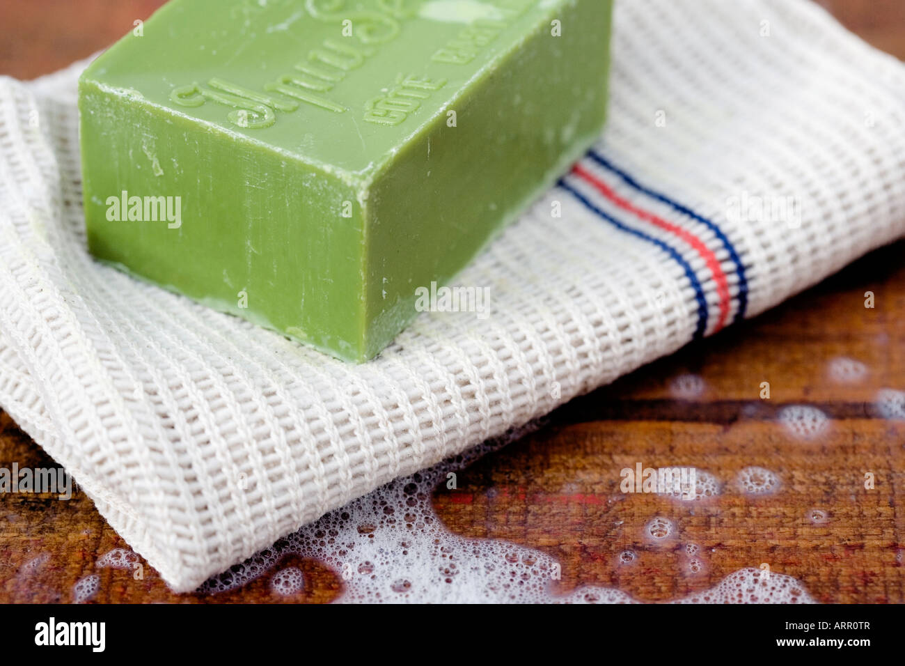 Bar of household soap with a traditional cloth - Stock Image