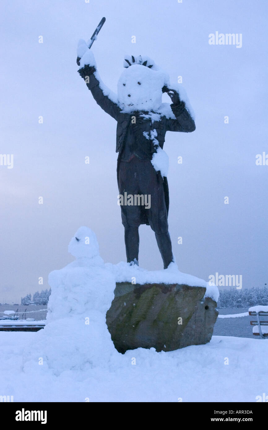 Legendary Black Frank statue with snowman makeover Nanaimo Vancouver Island British Columbia Canada - Stock Image