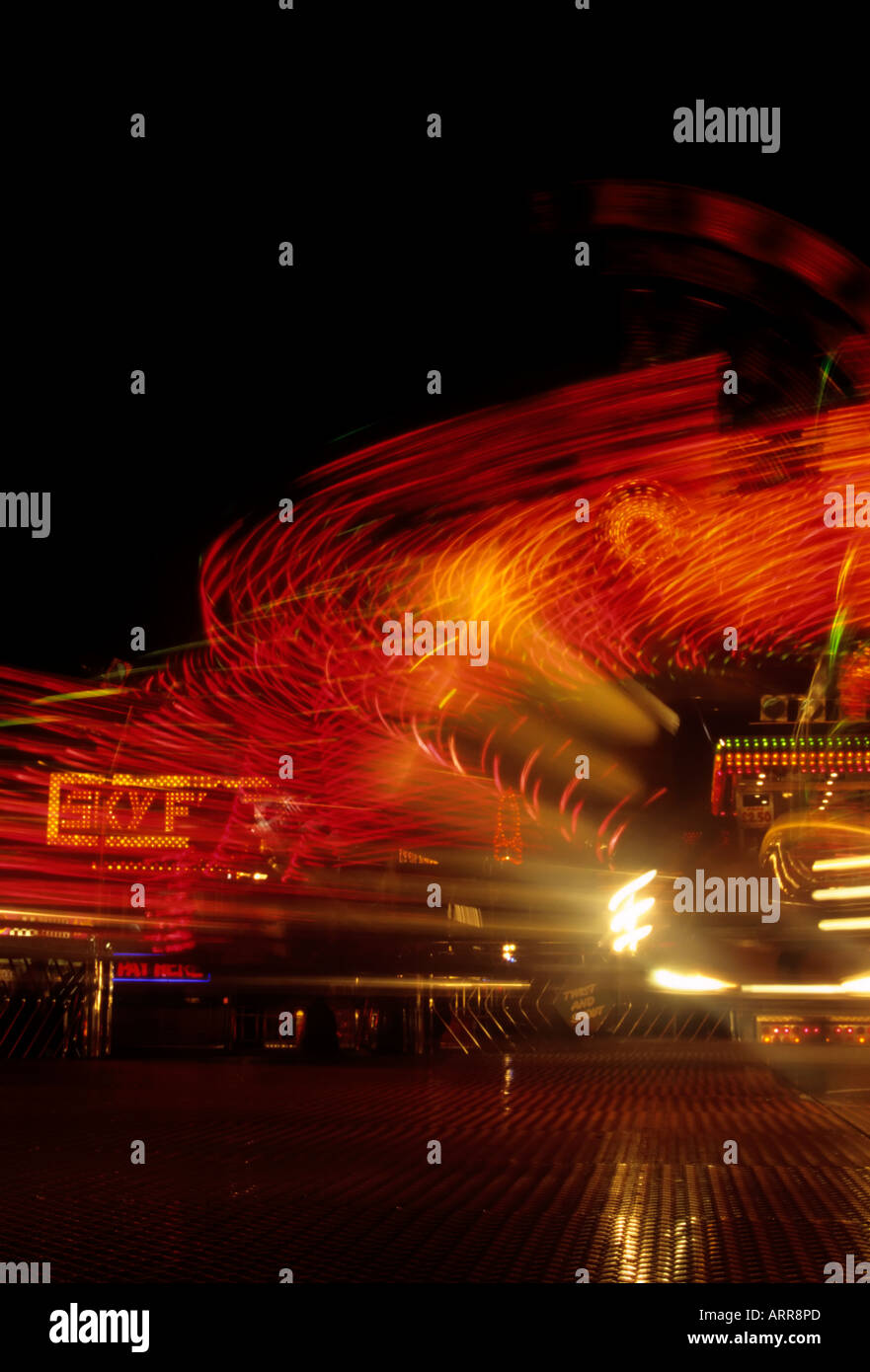 Light trails from fairground rides - Stock Image