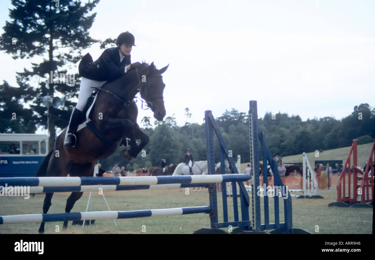 Young girl showjumping - Stock Image
