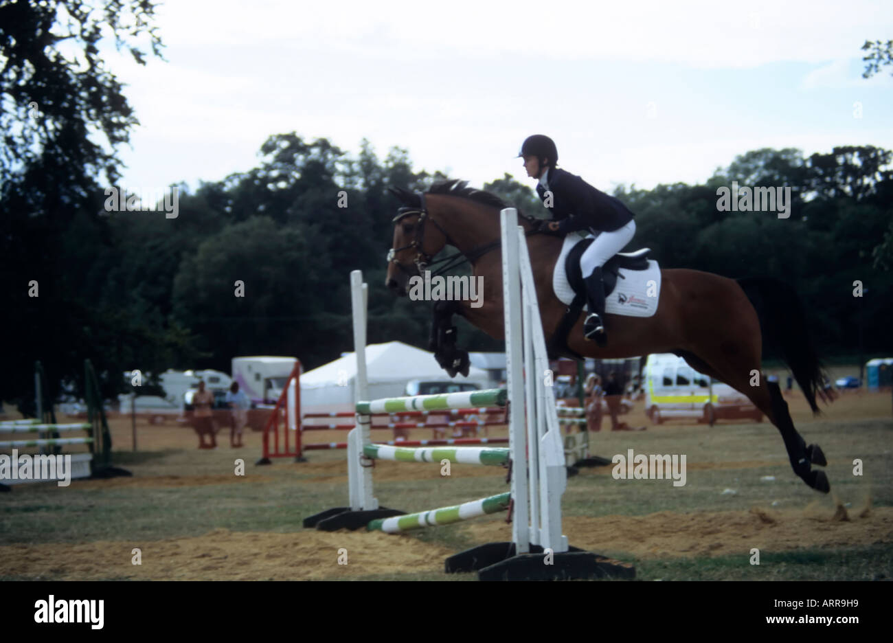 A horse and rider in action during the showjumping competition at the Romsey and Ellingham Country Fair 12th August 2006 - Stock Image