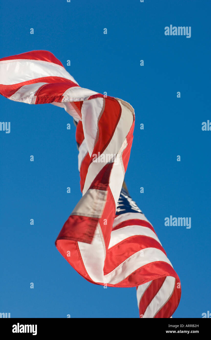 American flag waving blowing flapping stars and stripes re white and blue red white blue stars stripes culture patriot - Stock Image
