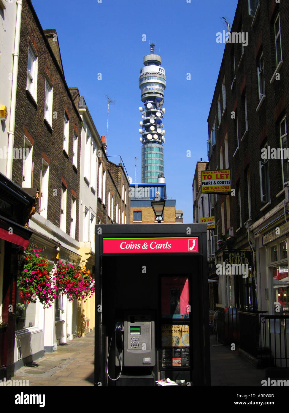 Telephone kiosk with BT Tower in the distance City of Westminster London England UK - Stock Image