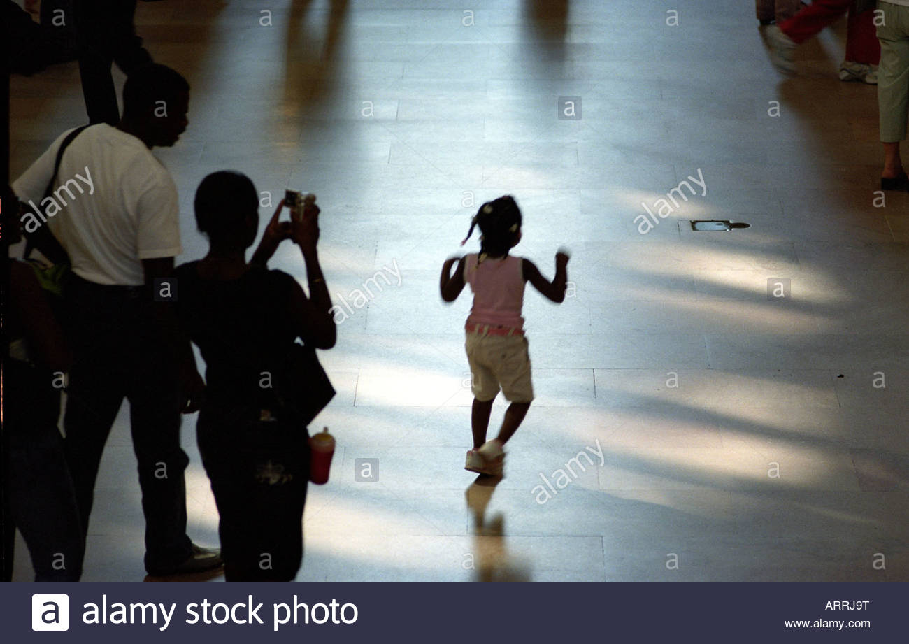 Grand Central Station Little Girl running and being photographed by parent Manhattan New York September 2007 - Stock Image