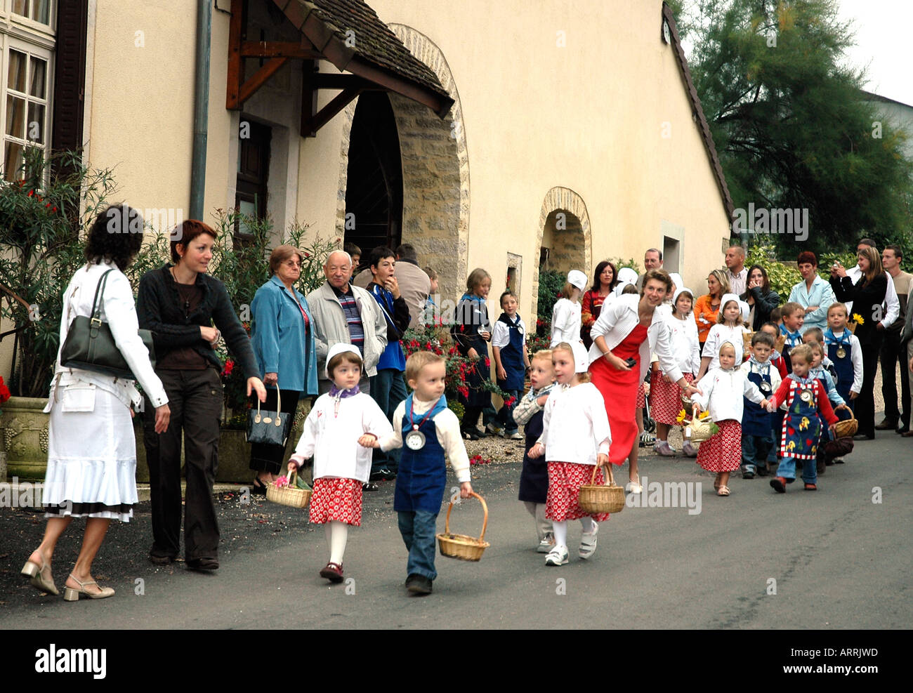 Children parade in the annual wine festival, or biou, in Pupillin, a winemaking village in France's Jura region Stock Photo