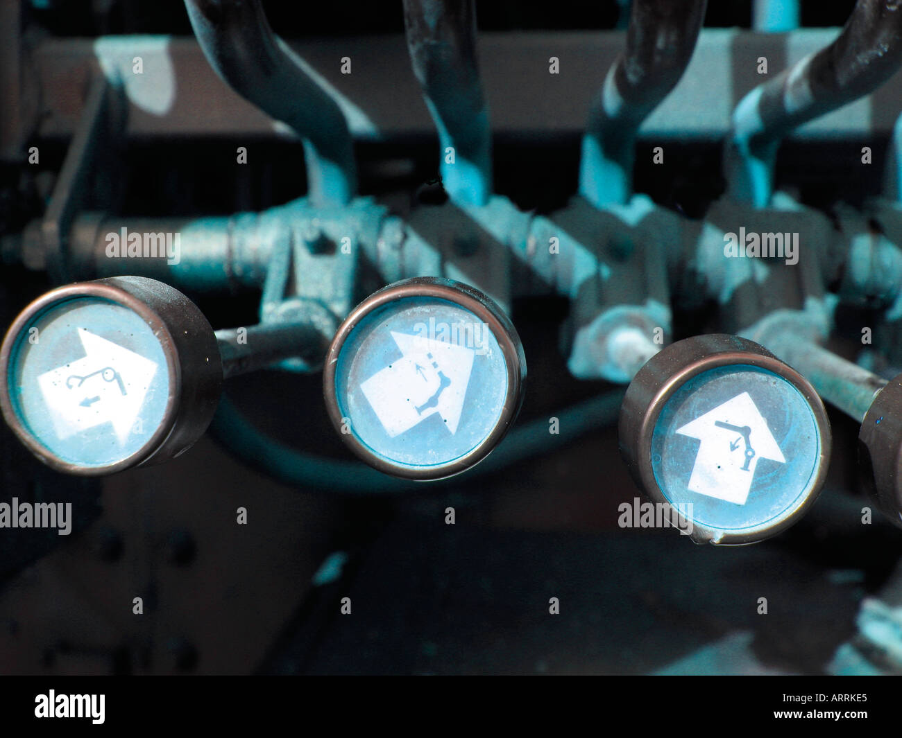 Arrows on machinery levers - Stock Image