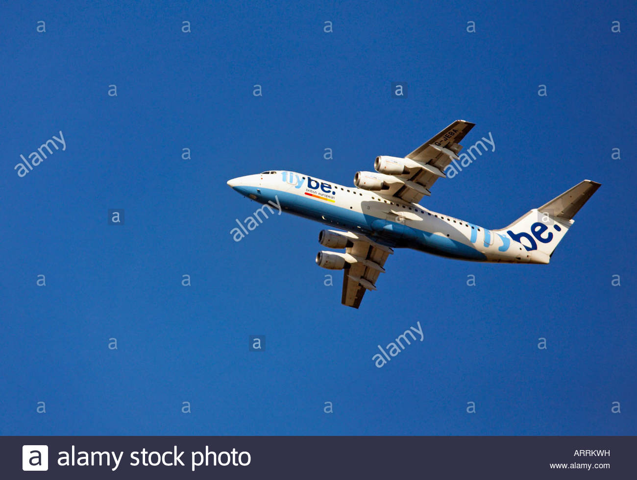 Flybe flight shortly after takeoff - Stock Image