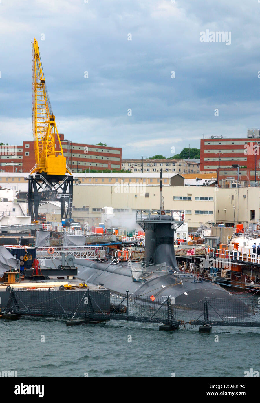 A Virginia class attack nuclear submarine undergoes work at a U.S. sub base in New London, Connecticut. - Stock Image