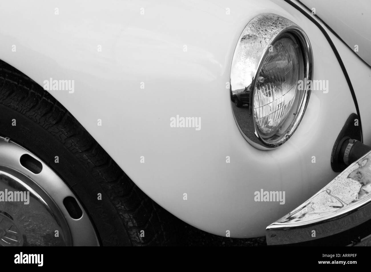 Detail of head light of volkswagen beetle in black and white - Stock Image