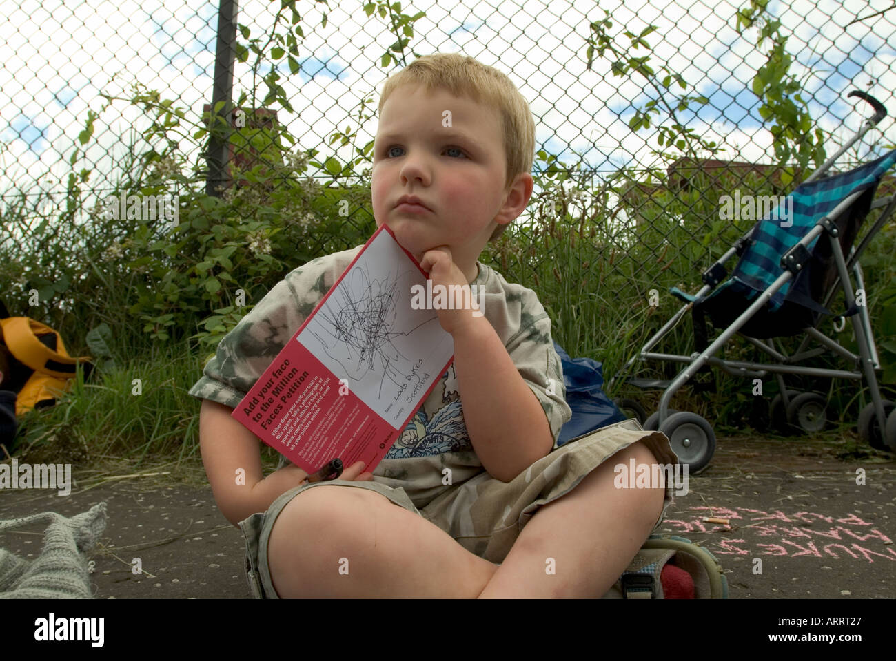 Young protester with petition. G8 rally, Faslane nuclear submarine naval base, Scotland, 2005. - Stock Image
