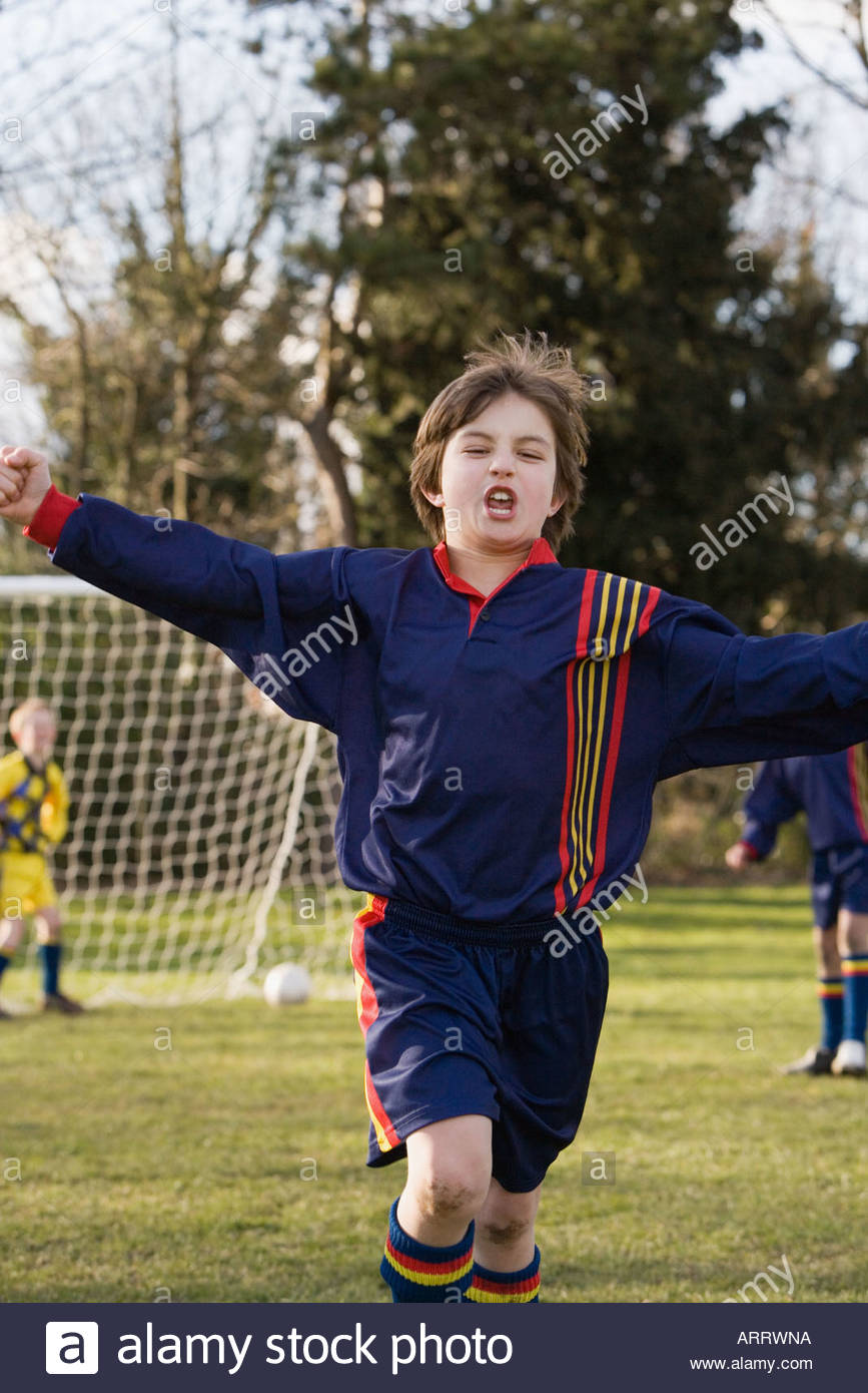 Boy celebrating - Stock Image