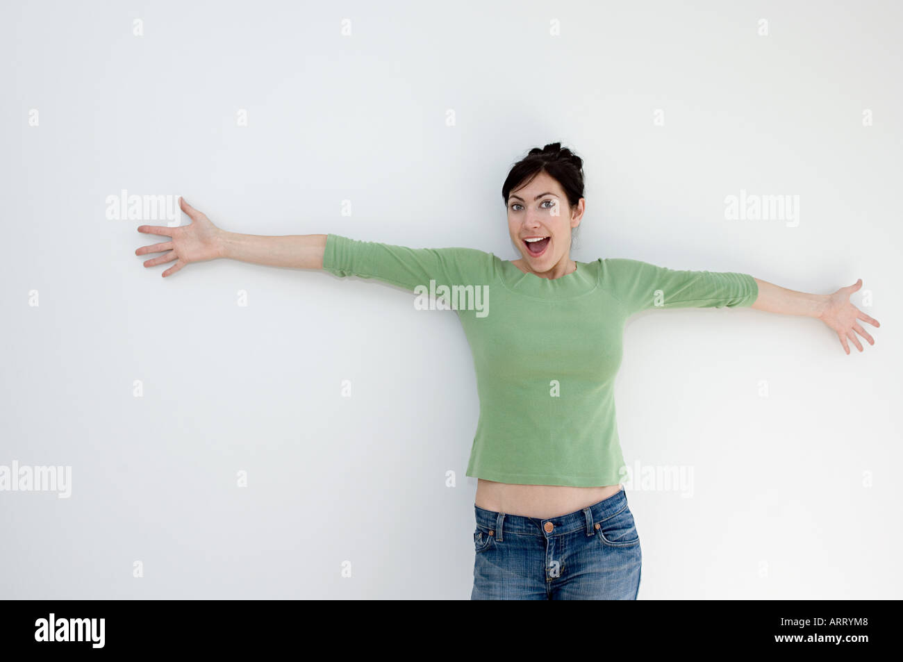 Woman with arms open - Stock Image