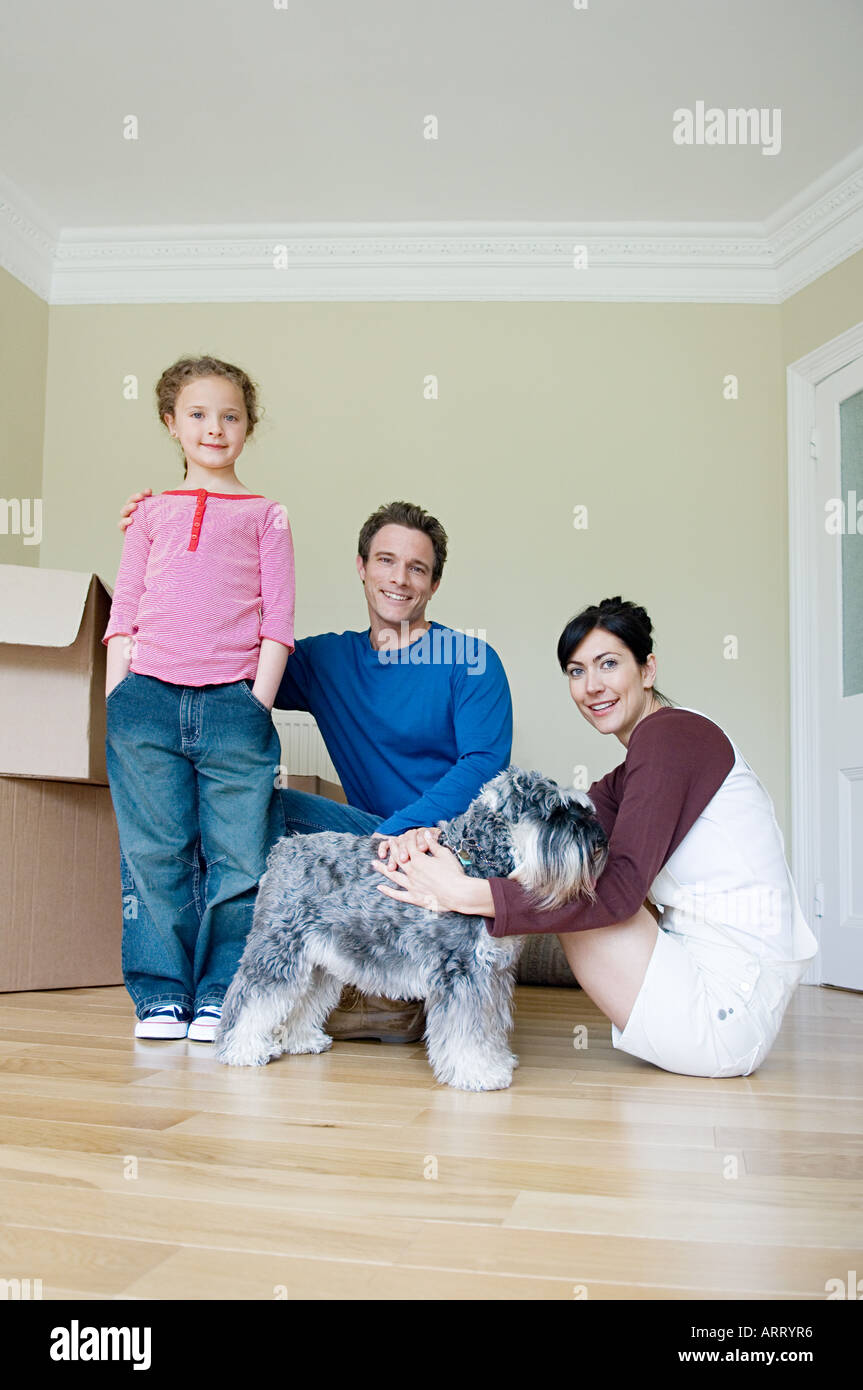 Family and dog in new house - Stock Image