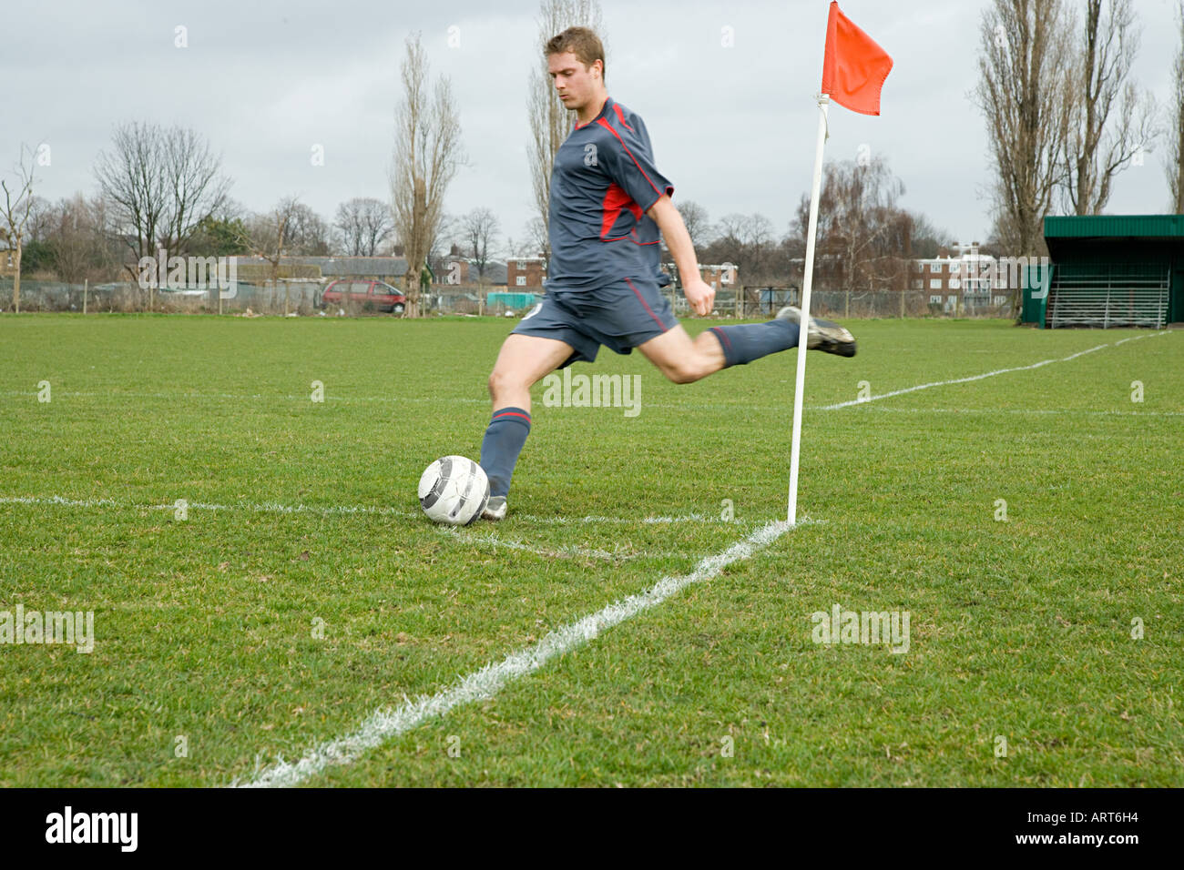 Footballer taking a corner kick - Stock Image