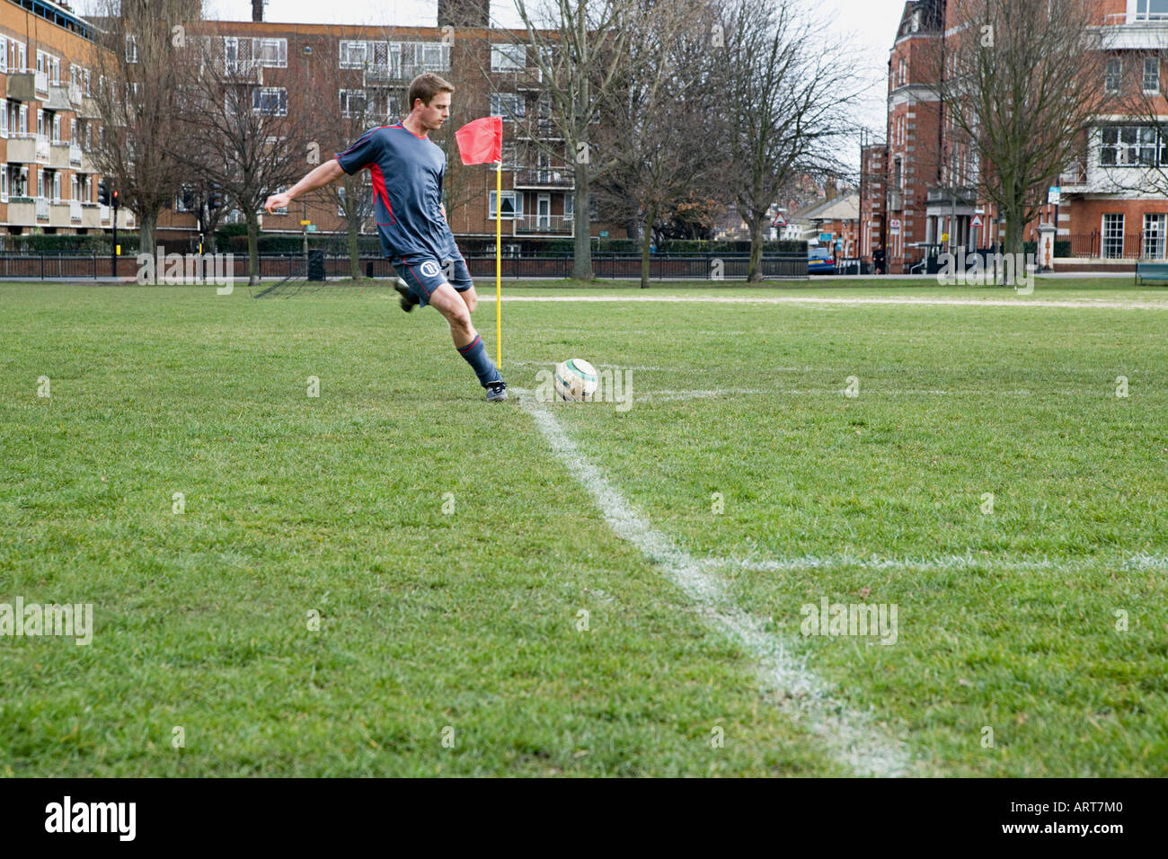 Footballer taking a corner - Stock Image